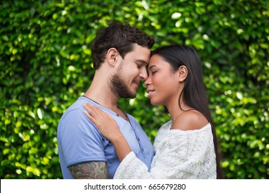 Interracial Couple Hugging and Touching Foreheads