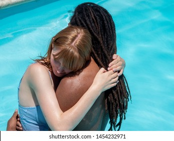 interracial couple in love, Hugged standing in the blue water pool