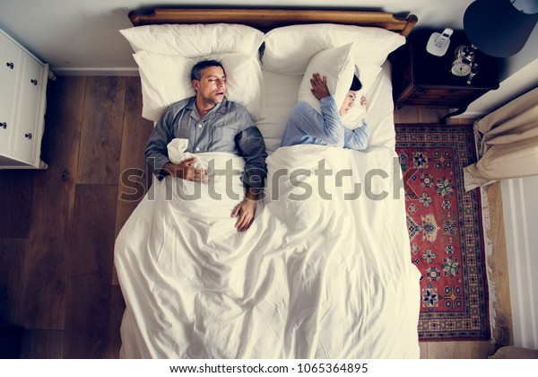 Interracial couple on the bed man snoring and disrupting woman