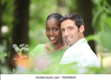 Interracial couple in a park.
