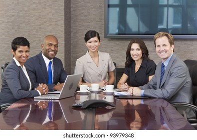 Interracial group of business men & women, businessmen and businesswomen team meeting in boardroom