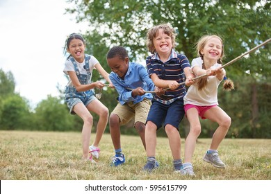 Interracial group of kids playing at the park