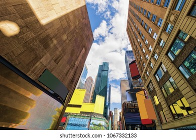 Intersection of 7th Avenue and West 44th Street in Midtown Manhattan, New York, USA. It is Times Square. It is a commercial intersection between Broadway and 7th Avenue