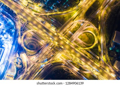 Intersection transport road with vehicle light movement aerial view