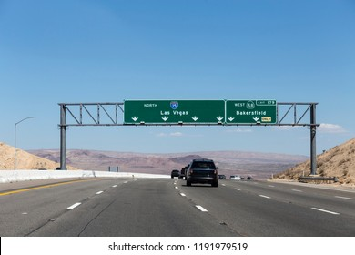 Interstate 15 Las Vegas freeway and highway 58 Bakersfield signs in the Mojave desert near Barstow, California.