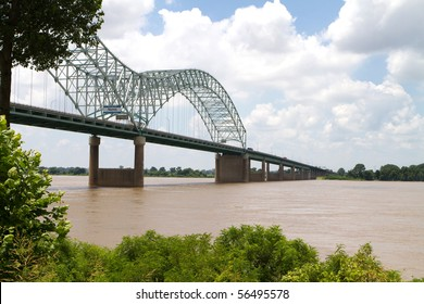 Interstate 40 bridge over the muddy Mississippi River connects Memphis, Tennessee, with West Memphis, Arkansas.