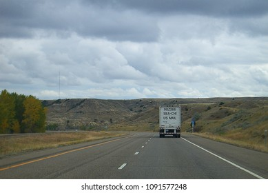 INTERSTATE 94, WYOMING – OCTOBER 4: US Mail truck shipping packages and letters on October 4, 2009 on Interstate 94 in Wyoming. The post office delivered 149 billion pieces of mail in fiscal year 2017