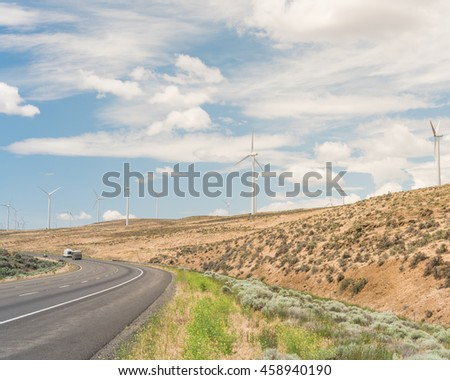 Interstate Highway I 90 Row Wind Turbines Stock Photo (Edit