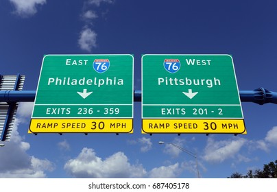 An interstate sign in Pennsylvania gives drivers the choice of driving to Philadelphia or Pittsburgh.