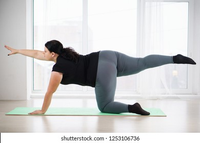 interval workout, activity, healthy lifestyle, sport, weight loss, tabata. overweight woman training abs on mat
