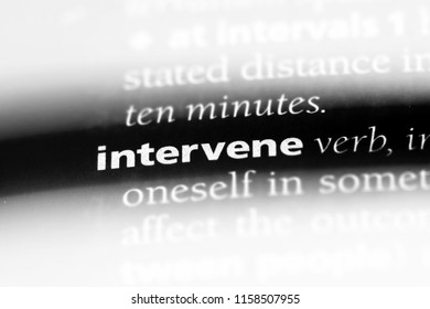 intervene word in a dictionary. intervene concept.