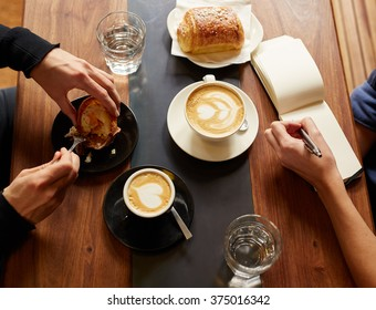 Interview in a cafe with coffee and pastry