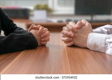 Interview or dialogue between politicians. Negotiation of two statesman with clasped hands in office.