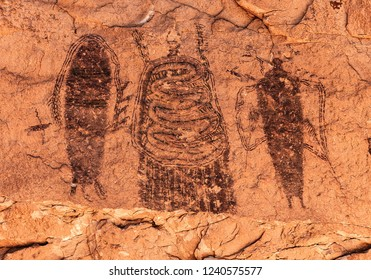 The Intestine Man Pictograph panel, an intricate example of Barrier Canyon Style rock art located on the way to Canyonlands National Park near Moab, Utah, USA.