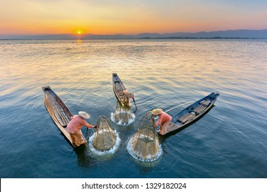 Intha fishermen in Inle Lake catching fish traditional way, Myanmar