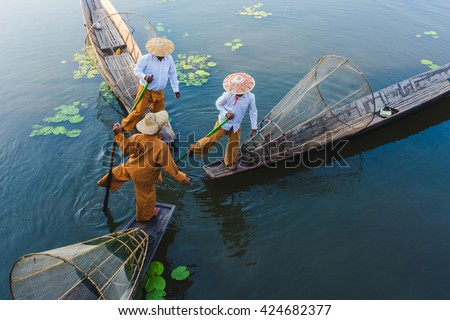 Intha fishermen working in the morning. Location of Inle lake, Myanmar.