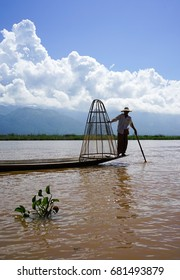 Intha man fishing on Inle Lake in Shan, Myanmar. Inle Lake is a freshwater lake located in the Nyaungshwe Township of Taunggyi District of Shan State.
