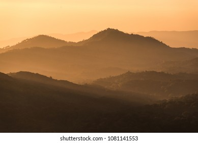 The Inthanon mountain ranges stretching across the landscape before sunset