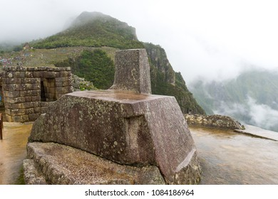 """Intihuatana (in english """"The place where the sun is tied""""): a unique stone sculpture and an important ceremonial place for the incas at the citadel of Machu Picchu"""