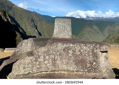 Intihuatana stone or Hitching Post of the Sun, Machu Picchu, Peru. Place to tie up the sun. Ancient inca monument Intiwatana is ritual stone in South America. Astronomic clock or calendar of the Inca.