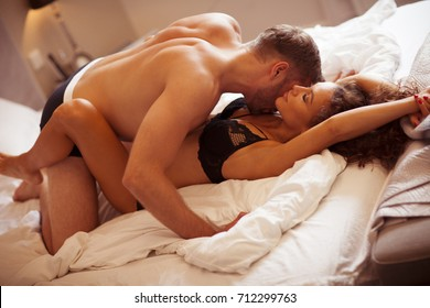 Intimate couple in bedroom. Two people making love.