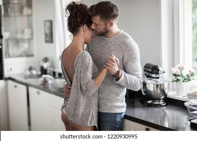 Intimate couple dancing in the kitchen.