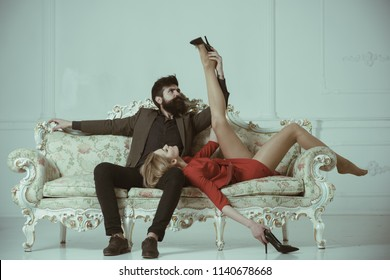 intimate moment of sexy couple. intimate caresses of bearded man and elegant businesswoman. intimate foreplay of attractive lovers. intimate concept