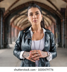 Intimate portrait of tattooed young woman. Berlin, Germany.