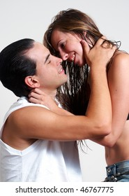 intimate young couple during foreplay on a light background