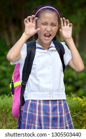 Intimidating School Girl Wearing Uniform