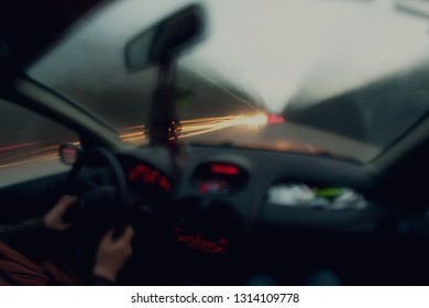 into a car on the country road, high speed motion, blurred background