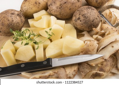 into very small cube cut organic potatoes with thyme
