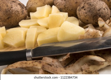 into very small cube cut organic potatoes