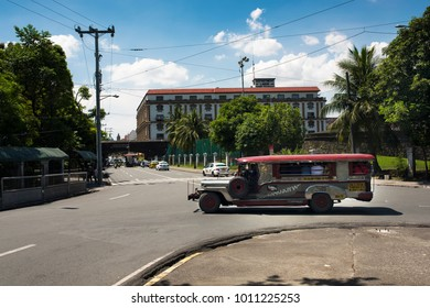 INTRAMUROS - MANILA - PHILIPPINES , APRIL 24, 2017; Historic Intramuros city entrance gate. Jeepney passenger bus. Jeepney vehicles are cheap and traditional passenger cars.