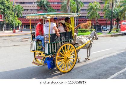 Intramuros, Manila, Philippines - July 29, 2018: Tourists On The Kalesa