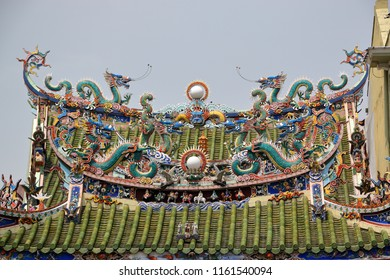 The intricate design of a chinese temple rooftop in Georgetown, Penang.
