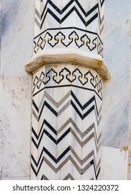 Intricate designs cover the facade of the Taj Mahal