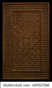 Intricate and detailed wood carving on door panel. An islamic or middle eastern art and craft.