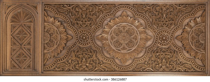 Intricate islamic wood crafted design. Islamic design carved on wooden panel.