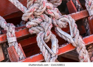 Intricate Seaman's knots using rope to secure.