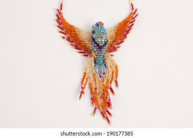 Intricately beaded fashion jewelry colorful exotic bird