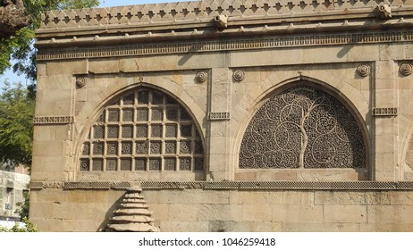 Intricately carved lattice stone window (Outside view) at Sidi Saiyyed Mosque, which is located in Ahmedabad, Gujarat, India.