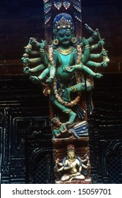 Intricately carved temple struts, Hindu goddess, temple worshippers,Patan,Nepal, Asia