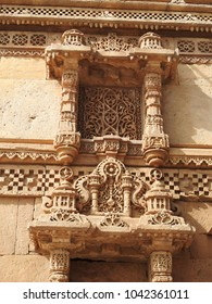 Intricately detailed motifs on the side wall of Adalaj Stepwell, which is located near Ahmedabad in the Indian state of Gujarat.