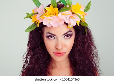 Intrigued excited good-looking young woman smiling from curiosity and interest listening carefully to interesting story. Colombian latin hispanic mixed race model in floral crown on head brunette hair