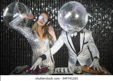 introducing mr and mrs discoball. two cool club characters DJ in a nightclub setting
