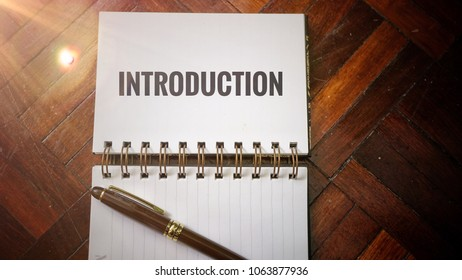 Introduction word on notepad for business concept
