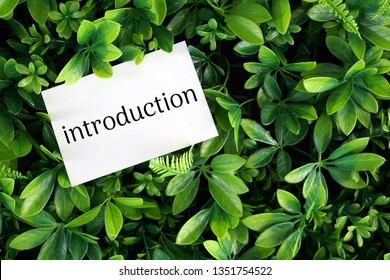 introduction wording on a white card over green leaves background