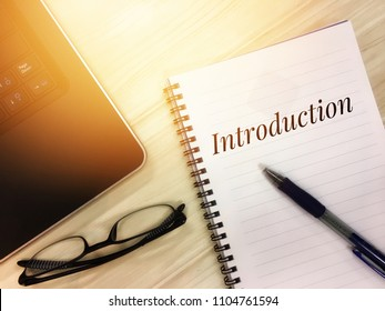 Introduction words on notepad. Business concept with toned image