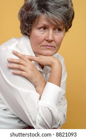 Introspective portrait of a lonely older woman